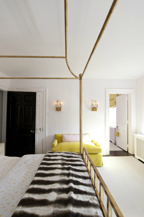 gorgeous bedroom with antique brass canopy bed dressed in white and yellow bedding and black and - Yellow Canopy Interior