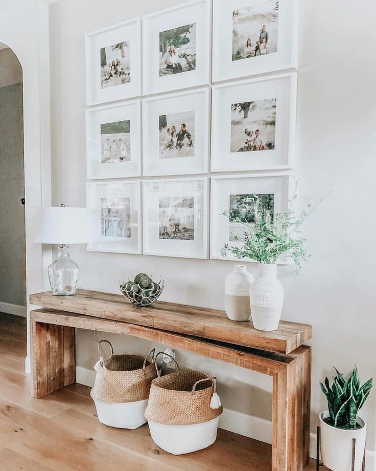Photo of modern farmhouse foyer design with rustic bench and wall gallery, neutral …