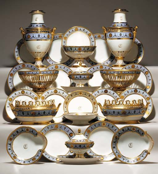 AN ASSEMBLED PARIS (DARTE FRERES) PALE-BLUE GROUND MONOGRAMED PART DESSERT SERVICE Circa 1810, iron-red uppercase stencilled mark to most pieces of form, the plates later replacements with iron-red retailer's mark for C. Richard