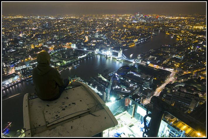Urban explorers climb to the top of the Shard in London. http://
