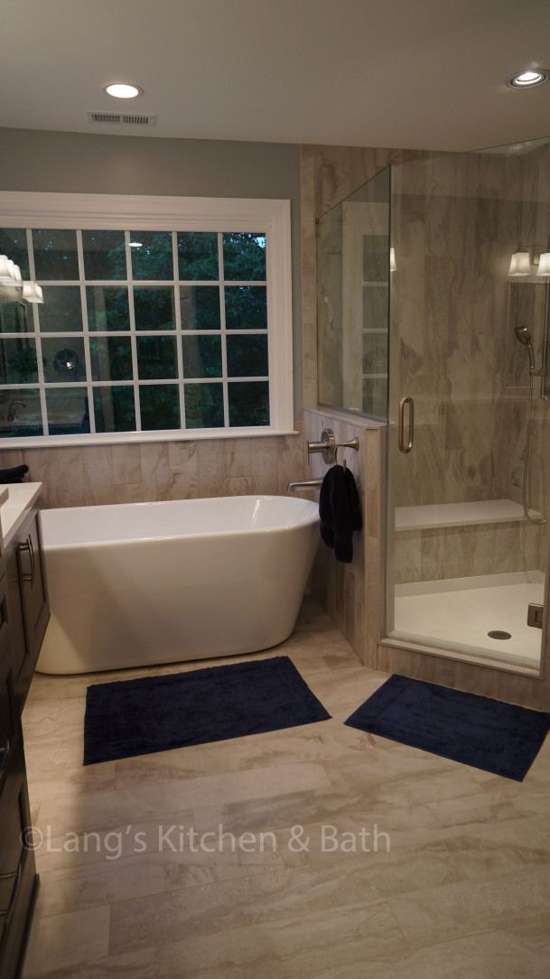 Photo of This transition style bathroom design offers a soothing retreat with …