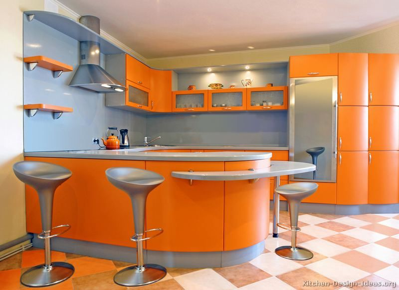 Complementary Kitchen Orange And Blue Are Opposite To Each Other On The Color Wheel Which Make T Metal Kitchen Cabinets Kitchen Design Modern Kitchen Colours