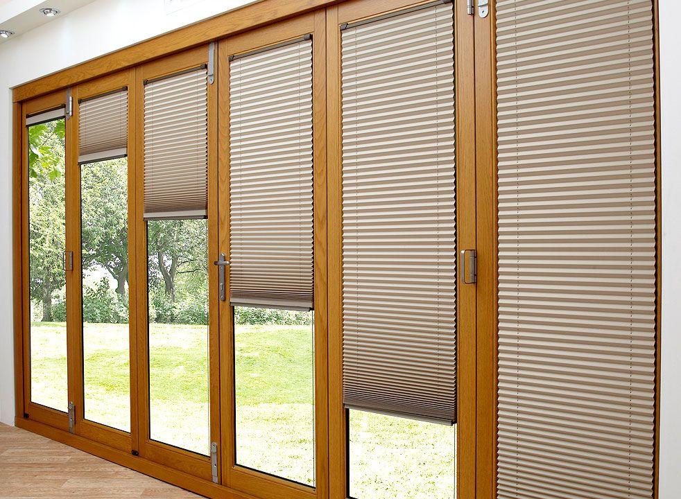 White Or Grey Aluminium Bifold Doors With 75mm Thick Door Available In Double Or Triple Glazing Vuf External Glass Doors Door Blinds Blinds For Bifold Doors