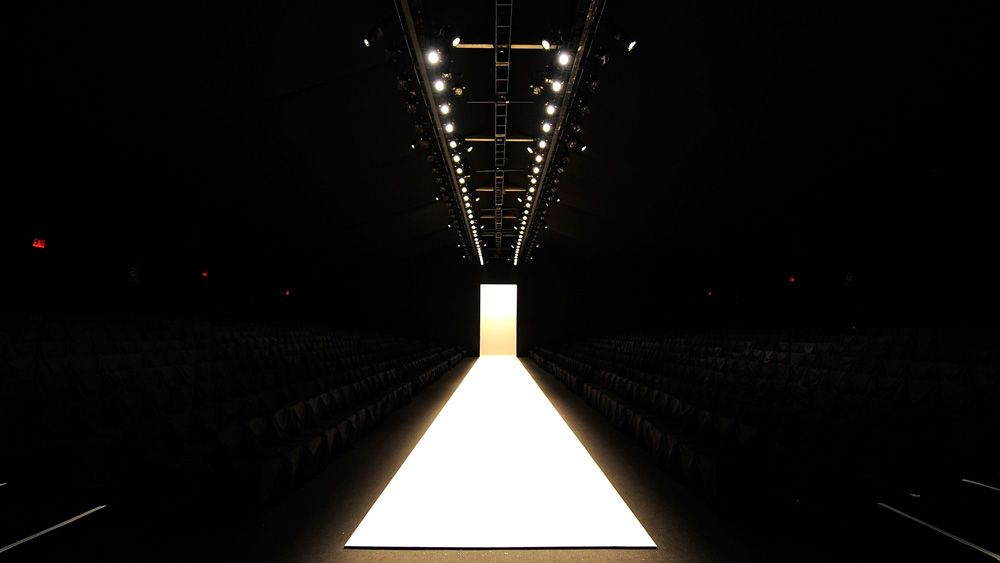 Empty fashion show runway stage with world runway for Runway stages