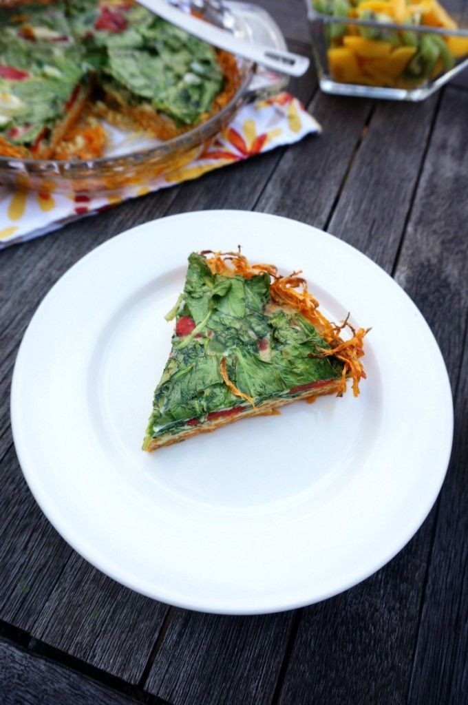 Shredded sweet potatoes create the base for a roasted red pepper and fresh spinach quiche, making this dish gluten-free, paleo, vegetarian, and delicious! Perfect for Easter brunch or a light dinner.