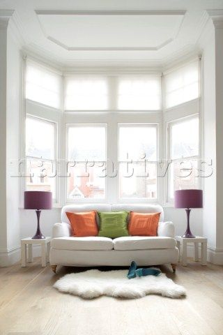 The purple green and orange accents add flare to this - Corner sofa in bay window ...