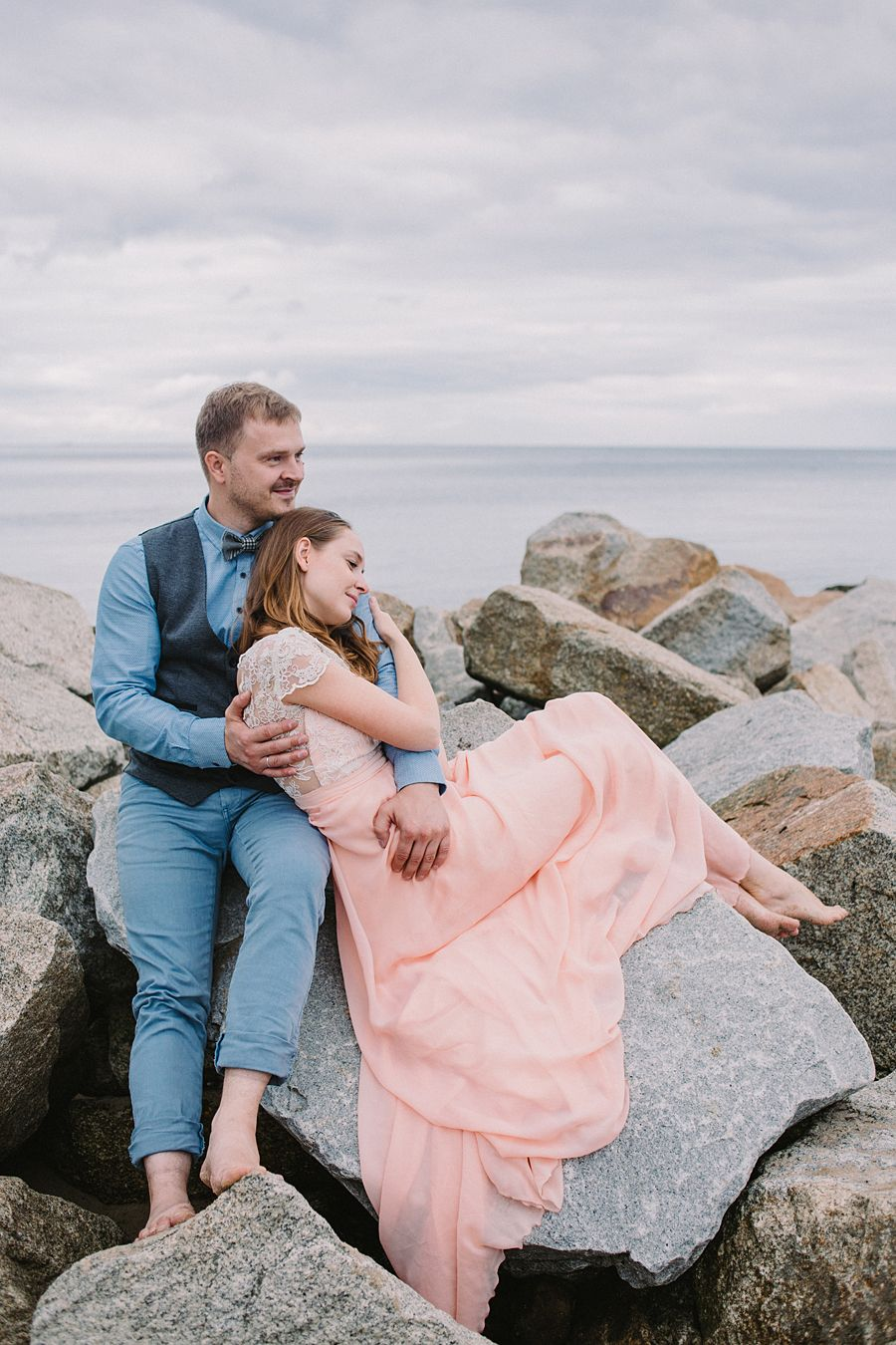 Beautiful Baltic sea wedding shoot. Pale pink wedding dress and grey-blue groom's outfit is just love!
