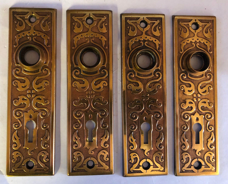antique passage door stamped art deconoveau pattern brass plates