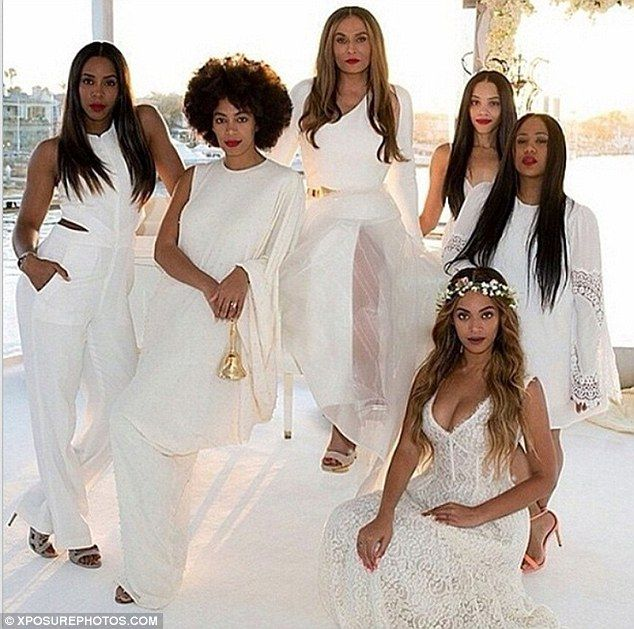 Tina Knowles 61 sizzles in red dress on cover of Ebony