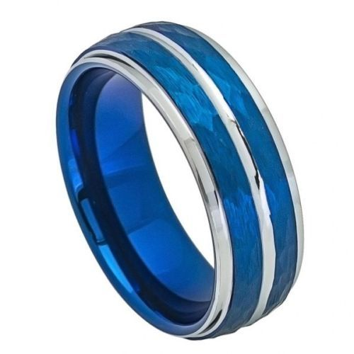 MSRP: $299.99  Our Price: $69.99  Savings: $240.00        Item Number: 704    Availability: Usually Ships in 5 Business Days        PRODUCT DESCRIPTION:    Crafted in durable Tungsten Carbide, this handsome wedding band for him features a Grooved Center and Step-Down Edge design with a Hammered Blue Finish.        FEATURES:      Crafted in Durable Tungsten Carbide  Scratch Resistent  Blue Hammered Finish  Grooved Center  Step-Down Edge Design  8.0mm Width          PRODUCT…