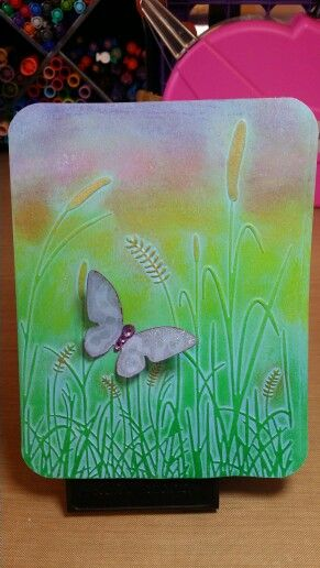 Card by Claire Morrison: Butterfly on Darice Grass Silhouette embossing folder. Background colored with Gelatos.