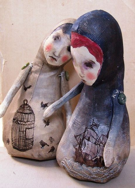 make simple doll with clay/paper mache/ paint/ put delicate painting/serviette on top, notice the button thing