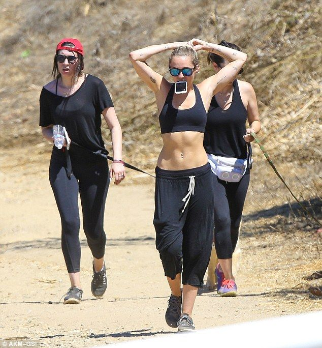 353d6b857b Defined  Miley s defined stomach was clearly on show in just a sports bra  and low-slung tracksuit bottoms as she went hiking with pals