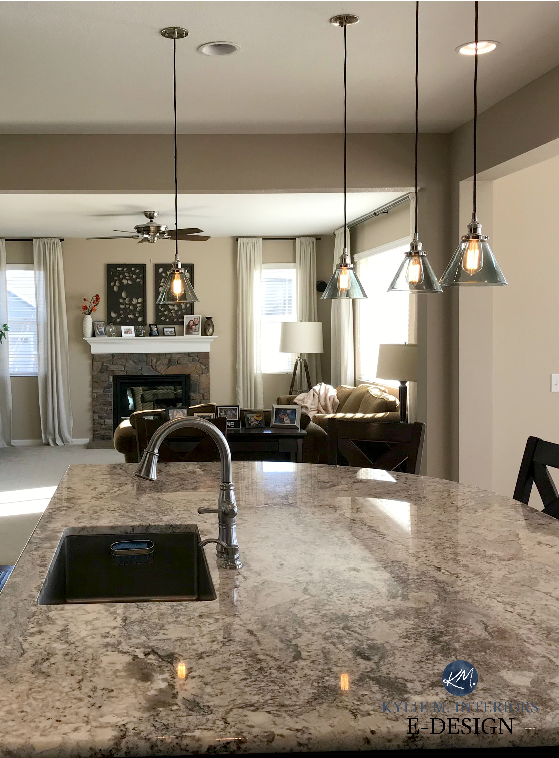 Sherwin williams barcelona beige in open layout kitchen and living room granite stone fireplace kylie m e design