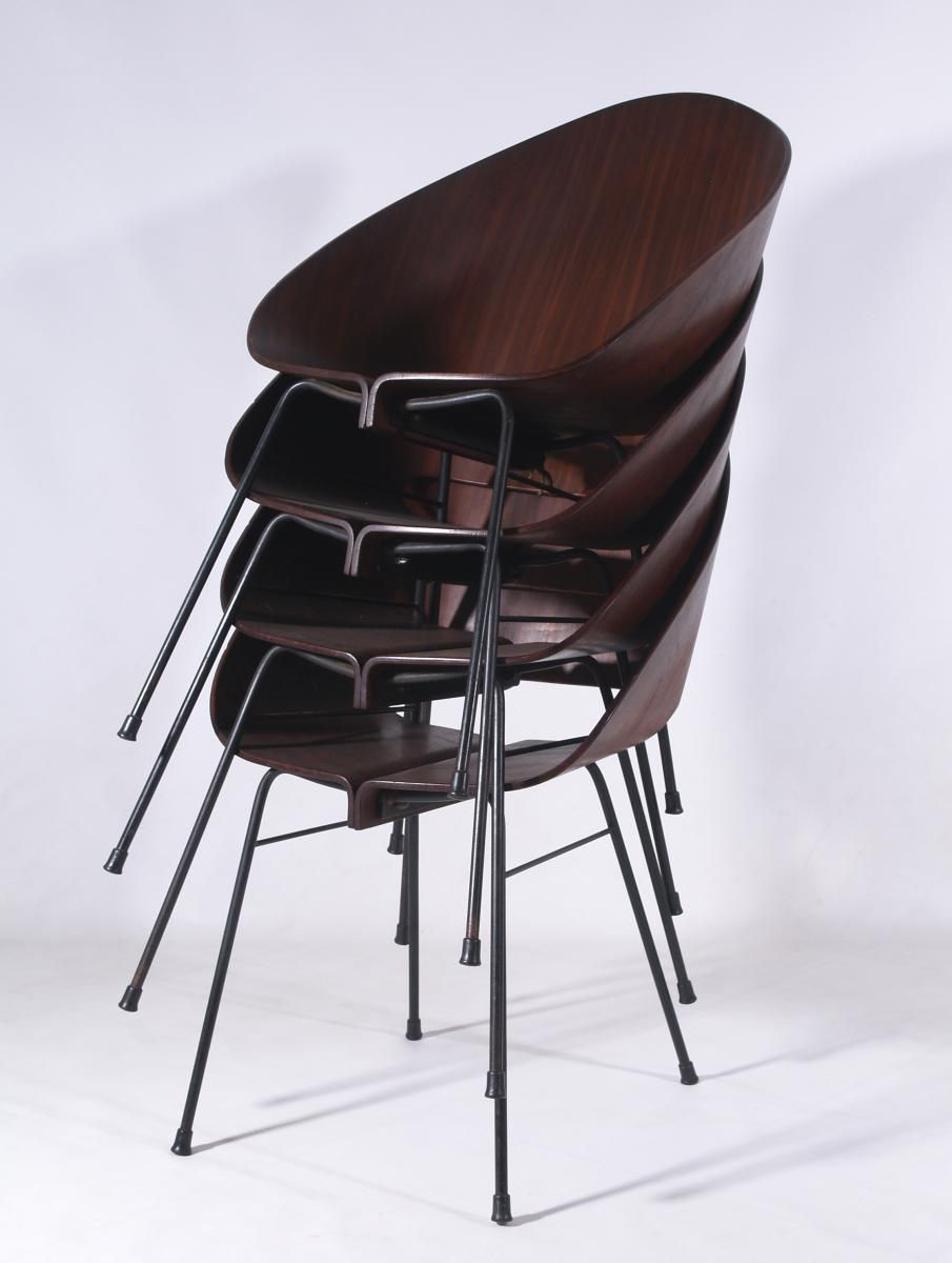 this stacking chair was manufactured in italy in 1950 the style of