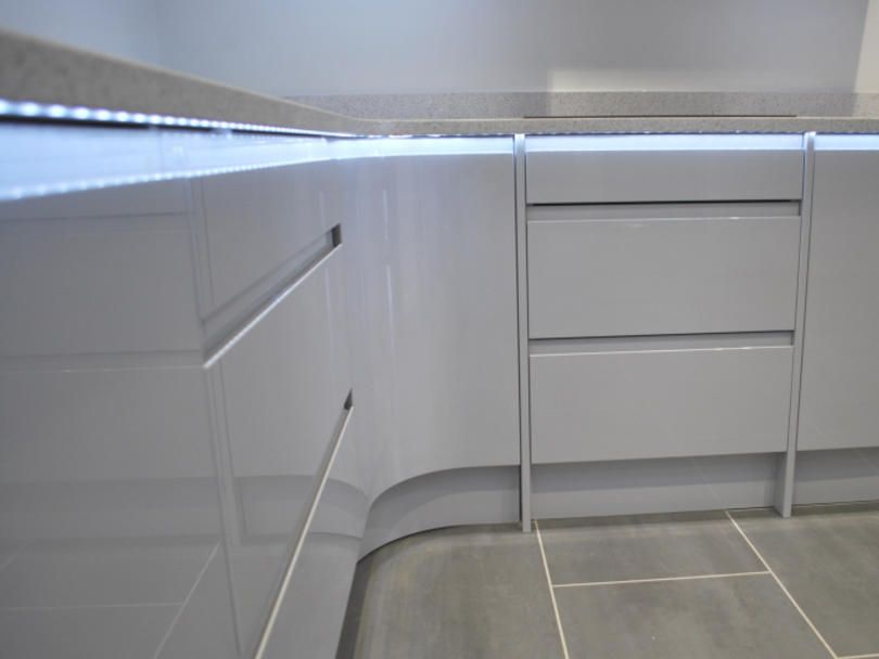 remo gloss white cabinets with under worktop lighting lights up this neutral coloured kitchen http - Kitchen Cabinet Down Lighting