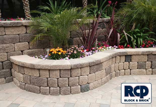 Photo gallery landscape wall idea gallery landscape for Retaining wall plants landscaping