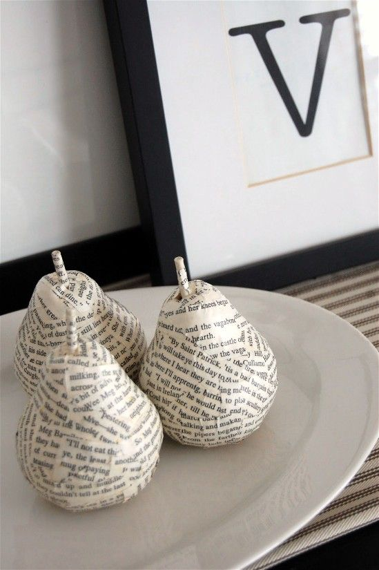 I personally think that the world should be decoupaged with book pages, so I was tickled when I came across these Anthropologie inspired pears by Emily from On the V Side. Emily took some pear ornaments that she had on clearance, spray painted them and then gave them this cute makeover. And now I ask you – what can you cover in book pages?