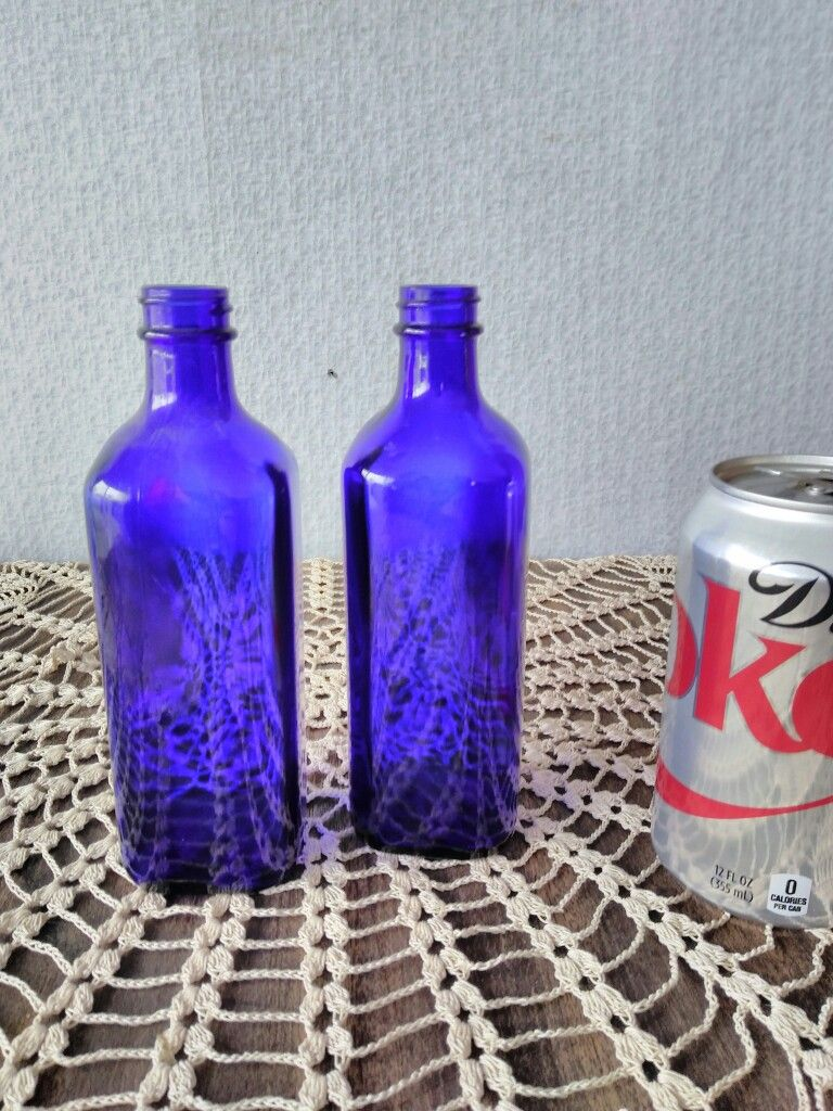 Vintage cobalt bottles,  10 in inventory   To rent this or any other items on this board, please call me at 801.427.2276