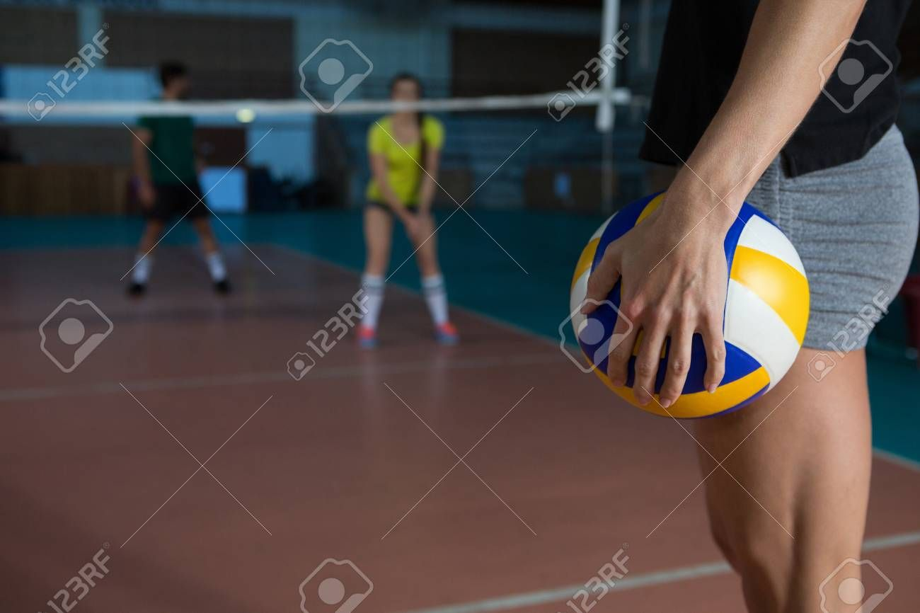 Mid Section Side View Of Female Player Holding Volleyball At Court Stock Photo Aff View Female Si In 2020 Flyer Design Inspiration Ball Exercises Stock Photos