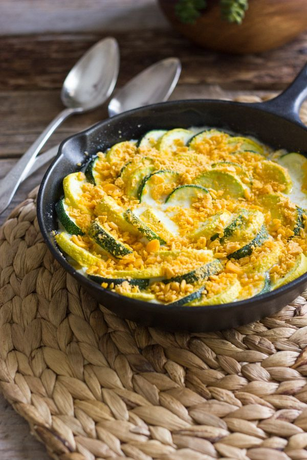 Tender crisp zucchini and yellow squash with a creamy white sauce with a cheesy, crunchy buttery cracker crumb topping.