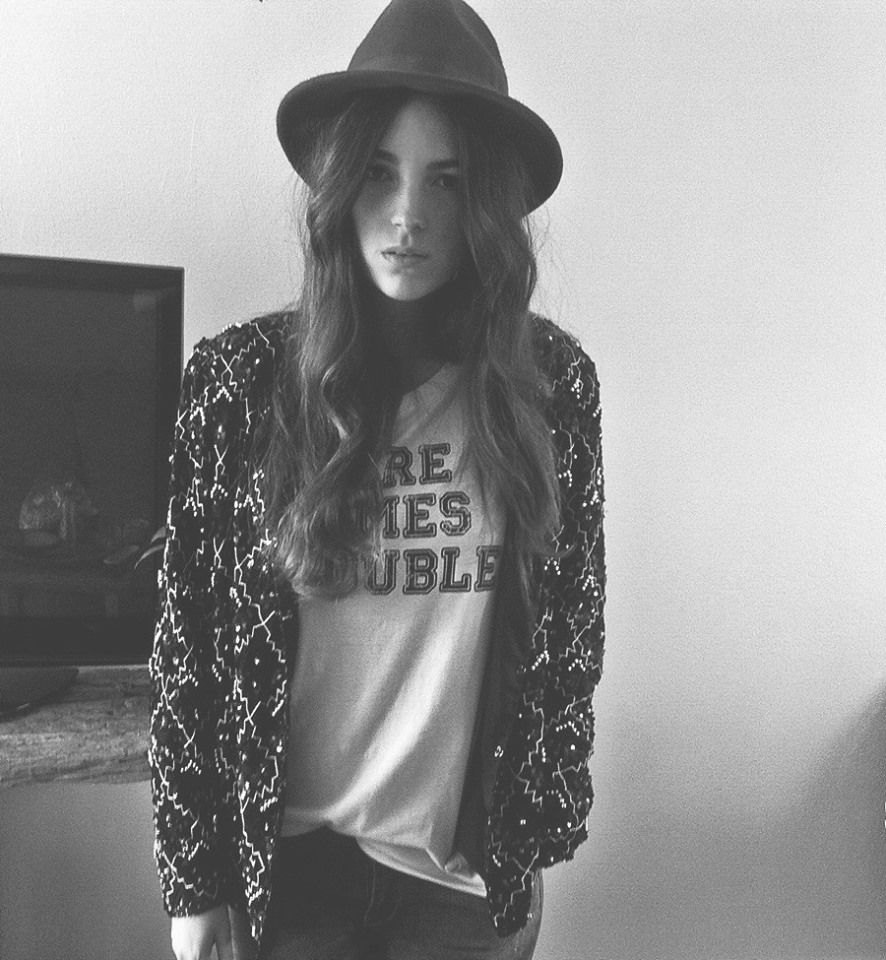 CATE ADRIANA B. blogginggggg about BLAKE SEVEN. She is rocking our '' Here comes trouble'' tee.