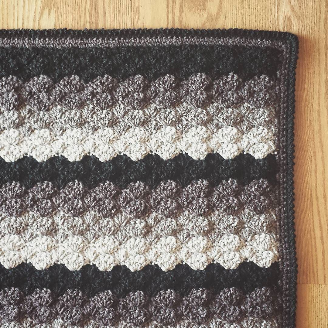 Simplistic beauty is timeless Thank you to everyone that helped with opinions about the color choice for the border!  Black won over color pop. And I LVE it!! Also that border may look like crab stitch (a stitch I just can't maneuver) but it's actually a twisted single crochet! @mooglyblog has the instructions on her blog. Go learn a new stitch today or master that crab stitch look without the drama by sohookedbysam