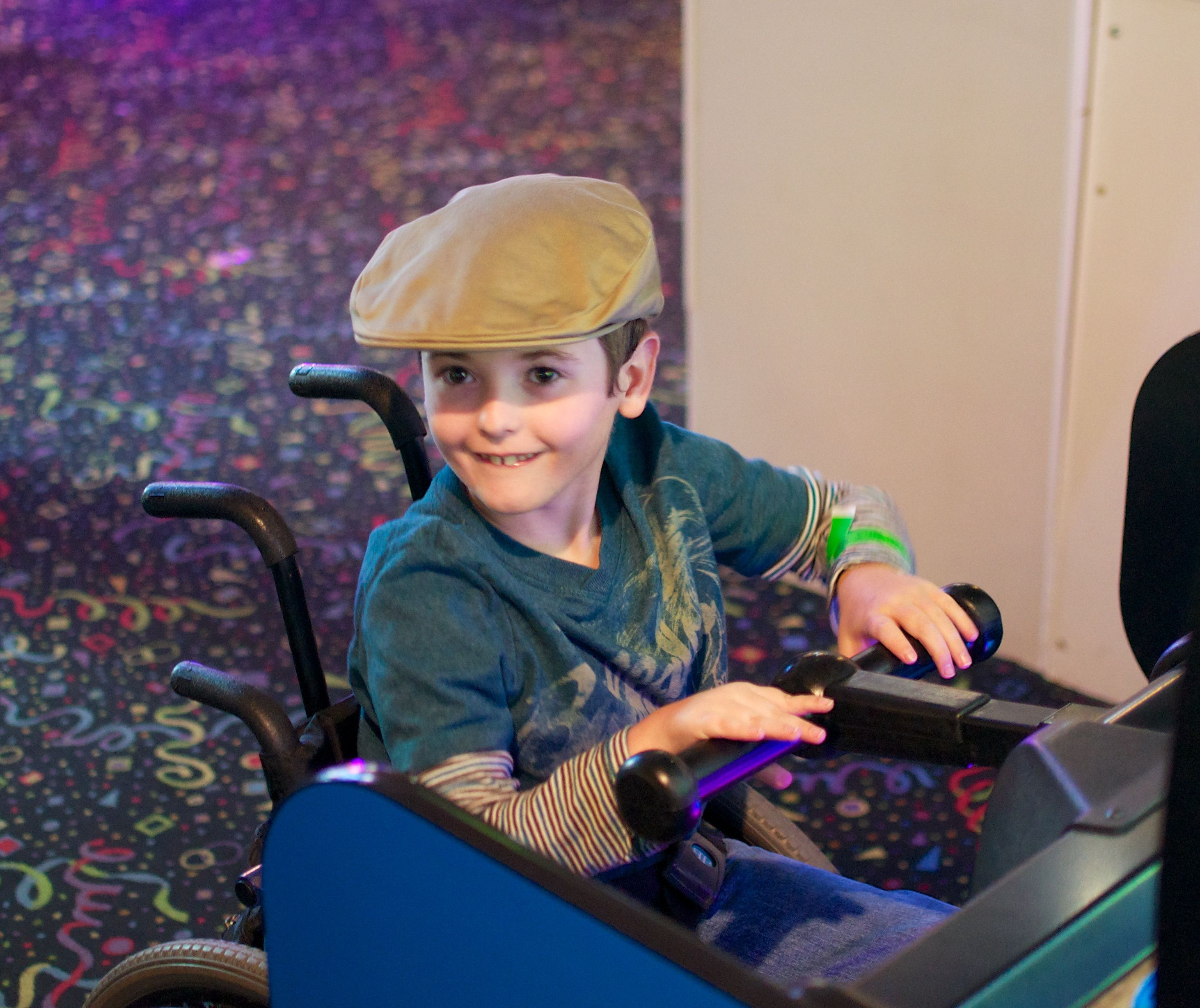 This adorable little boy is enjoying improved wheelchair accessibility at Jungle Rapids!