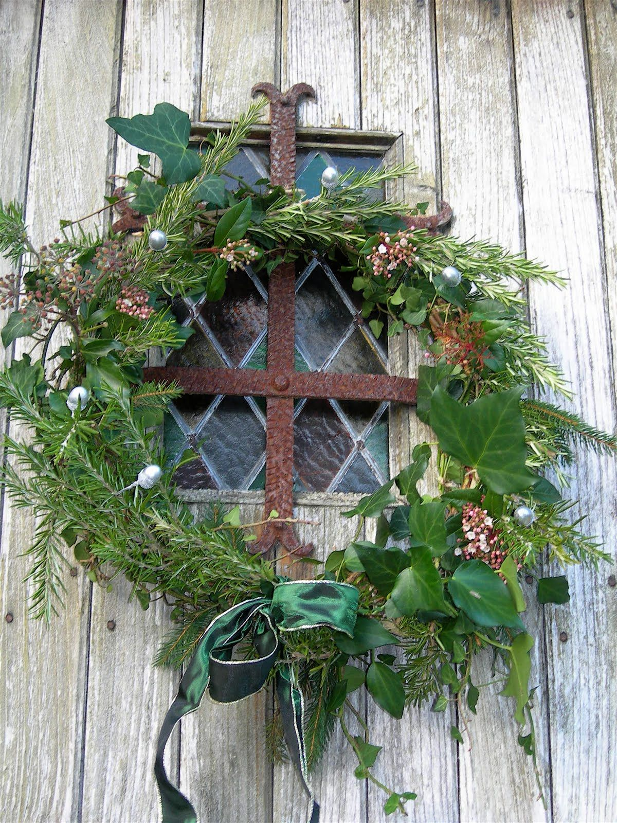 wreath over a pretty window - or set one behind an old window as display