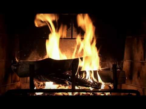 Just the yule log. A crackling popping fire...no holiday music ...