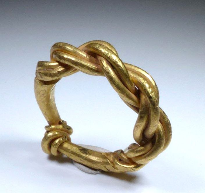 Viking or late Anglo-Saxon, ca. 10th to 11th century CE.  Pure gold, a finger ring formed from plaited, continuous twisted rods, thicker at the bezel.  Size:  US ring size 8, weighing 17 grams. <BR><BR> Provenance: Ex-private UK collection.<BR><BR> <i>This item will be shipping from the UK.  If your shipping address is within Europe, please be advised that your purchase may be subject to VAT. </i><br><br> All items legal to buy/sell under U.S. Statute covering cultural patrimony Code 2600…