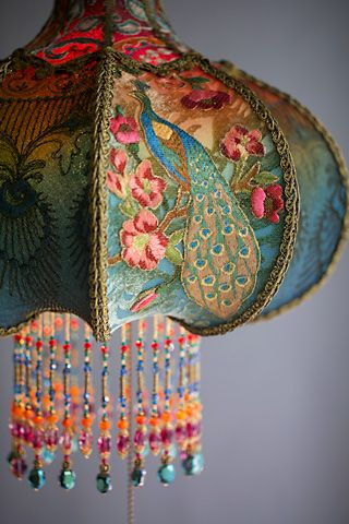 detail of bohemian peacock vintage lamp decor hand beaded by artist