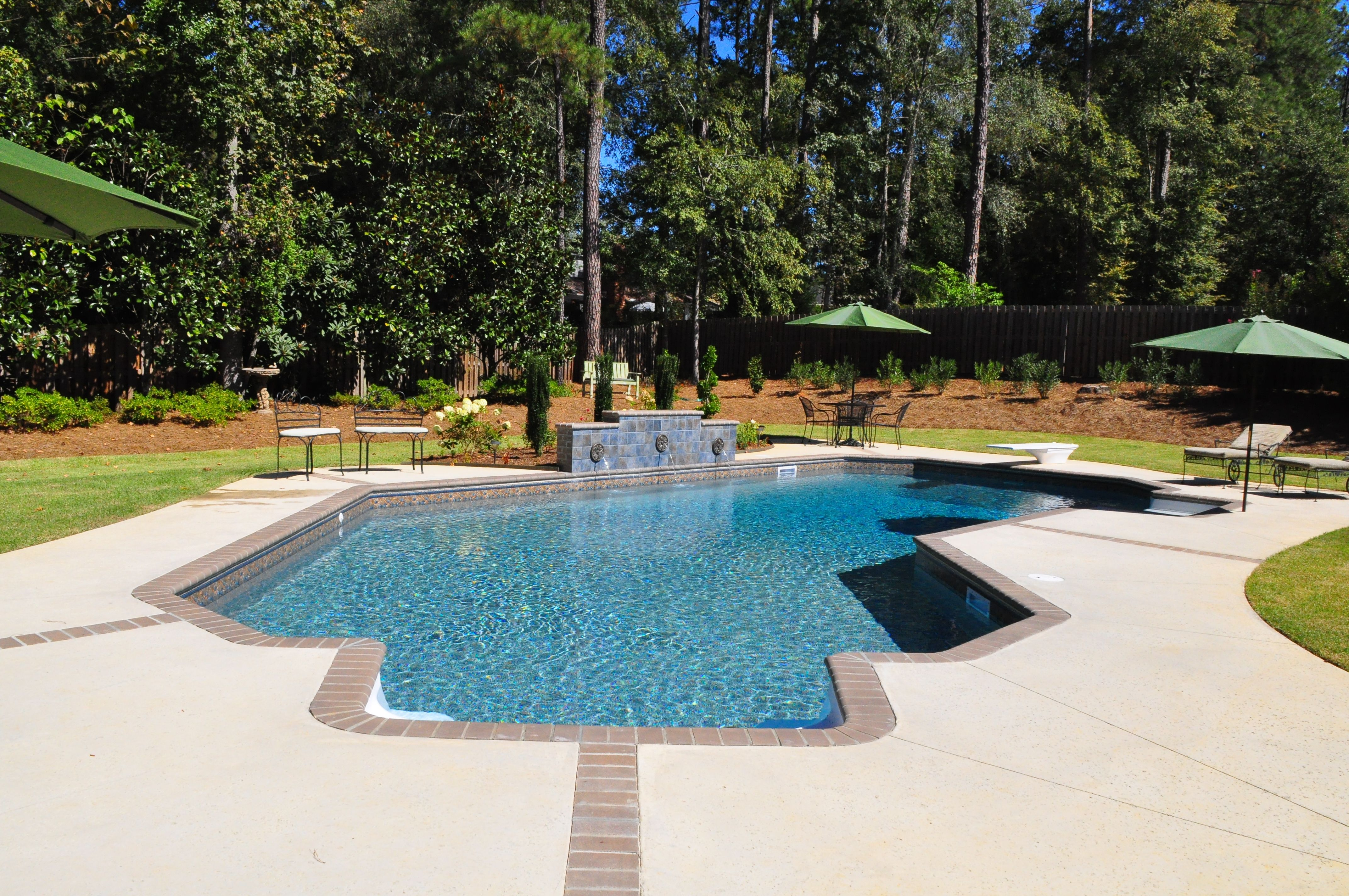 Lazy l vinyl swimming pool with brick expansion joints in