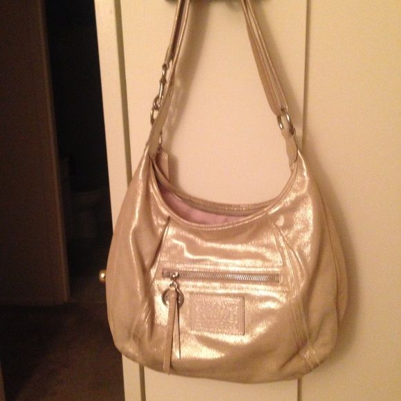 REDUCED Authentic COACH Poppy Shimmer Leather Hobo Authentic COACH Poppy Shimmer Leather Shoulder Hobo Bag No M1069-16374 in Platinum. Kudos to the salesgirl who probably made a fortune in commission on me! It's really hard to photograph this shimmer leather, so I've included a stock photo above. This is a really beautiful purse, Edges and back have some wear along with the strap. The inside is near immaculate.  Matching wallet is listed separately. Coach Bags Hobos
