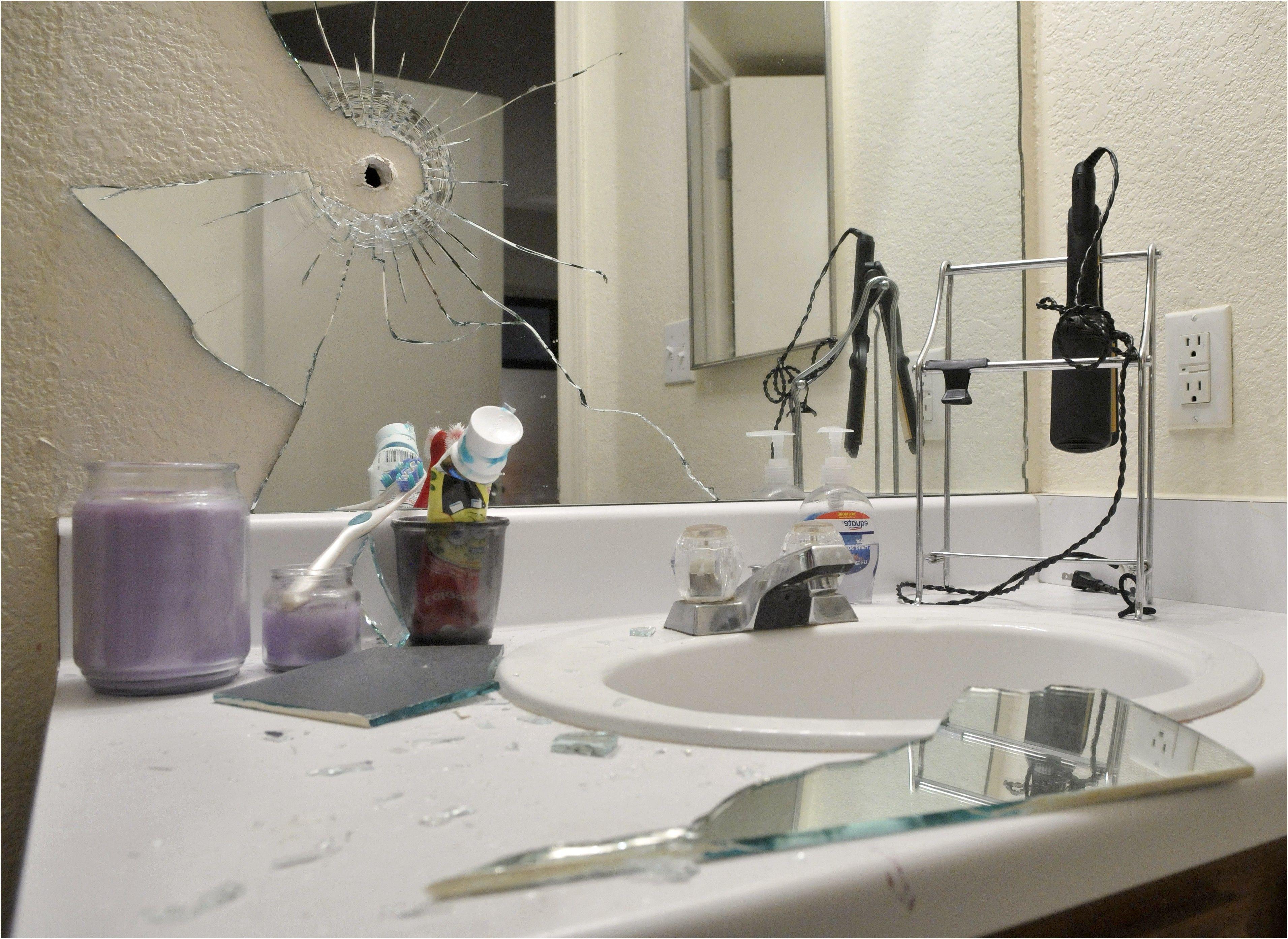Broken mirror in bathroom universalcouncilfo from broken bathroom mirror for Shattered mirror bathroom floor