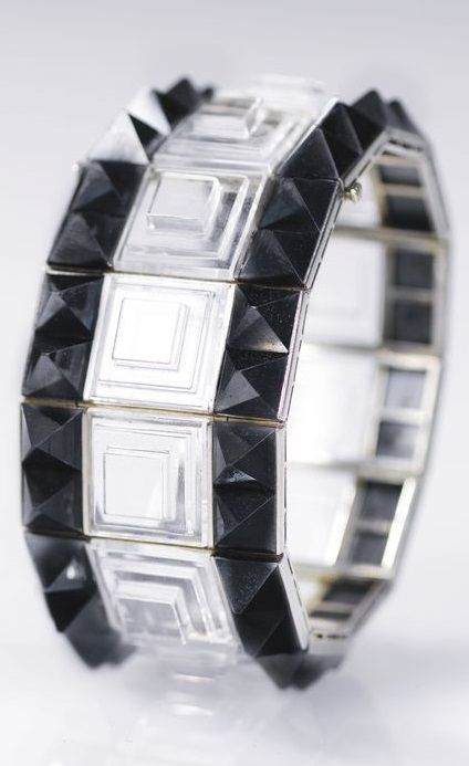 Rock crystal and hematite bracelet, 'Escalier Bordé', René Boivin, 1930. Designed as an articulated band of tiered square rock crystal plaques, set between rows of pyramidal hematite motifs, French assay marks. #Boivin #ArtDeco #vintage #bracelet