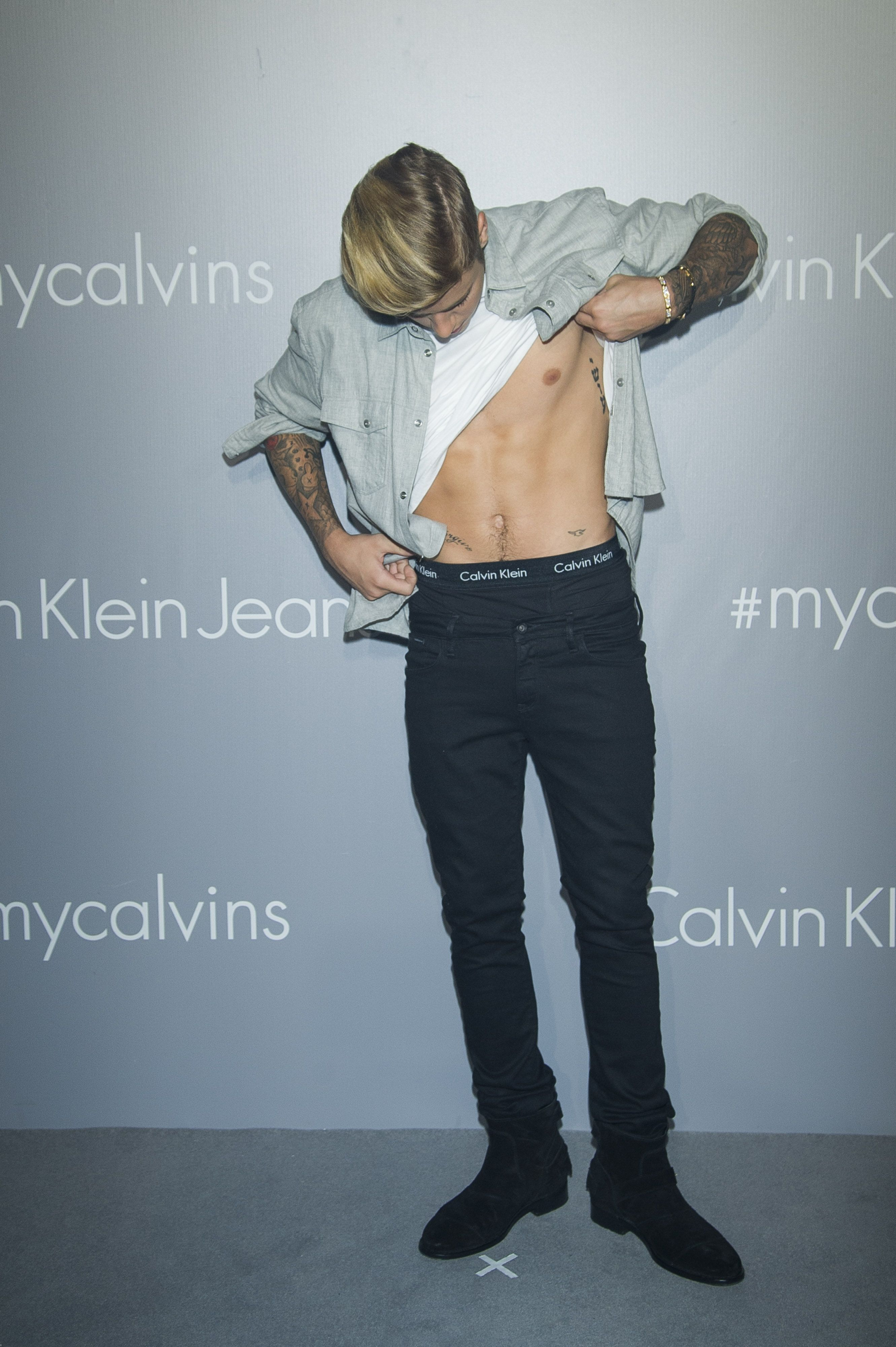 Justin Bieber showed off a lot more than just his singing voice at a recent Calvin Klein event in Hong Kong. See more of his steamy snaps, including ones that feature his impressive abs.