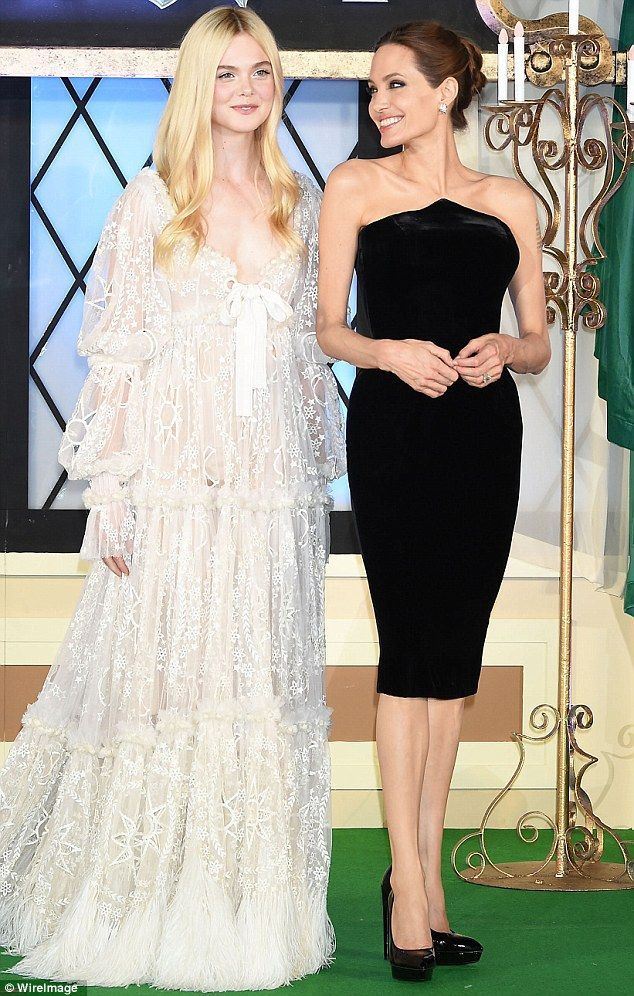 Angelina Jolie looks stunning in form-fitting black dress -  Stunning: Elle Fanning and Angelina Jolie attend the Tokyo premiere of Maleficent on Sunday evening - #Angelina #AngelinaJolie #Black #CelebrityStyle #dress #formfitting #HollywoodActresses #Jolie #Stunning