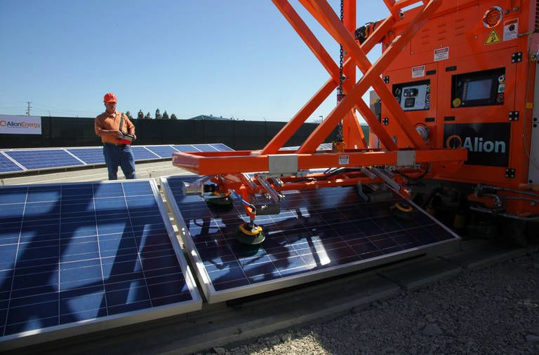 A Staff Of Robots Can Clean And Install Solar Panels Best Solar Panels Solar Panels Solar Energy Projects
