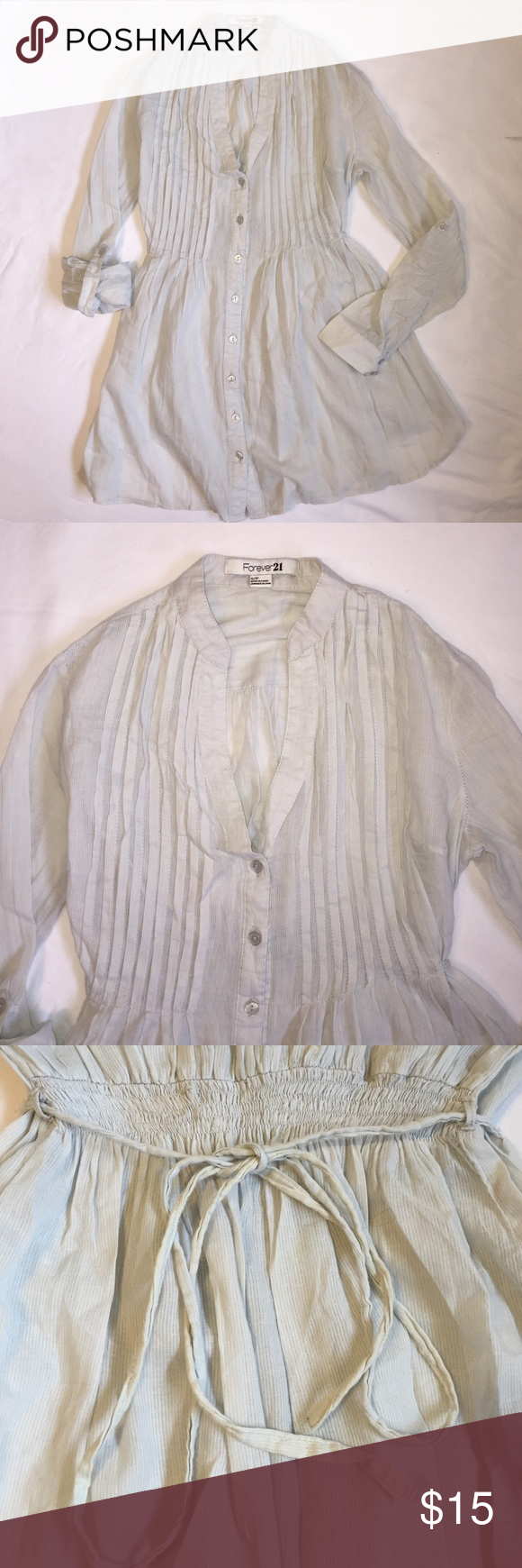Forever 21 Light Pleated Blouse Size Small Tunic style, light and airy feel perfect for summer. Loose fitting style and features tie on sleeves so that they can be rolled up. Pastel blue/green color with very thin pinstripe. Pleated detail in the front. Ties at back. No rips, tears or stains besides a little pit of pulling from when you tie it in the back (see pictures). Please ask any questions you may have prior to buying. Thank you! Forever 21 Tops Blouses