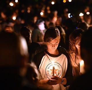 People gathered for a vigil in Roseburg, Oregon on October 1, hours after a shooting at Umpqua Community College. (Josh Edelson/AFP/Getty Images) #UCCShooting