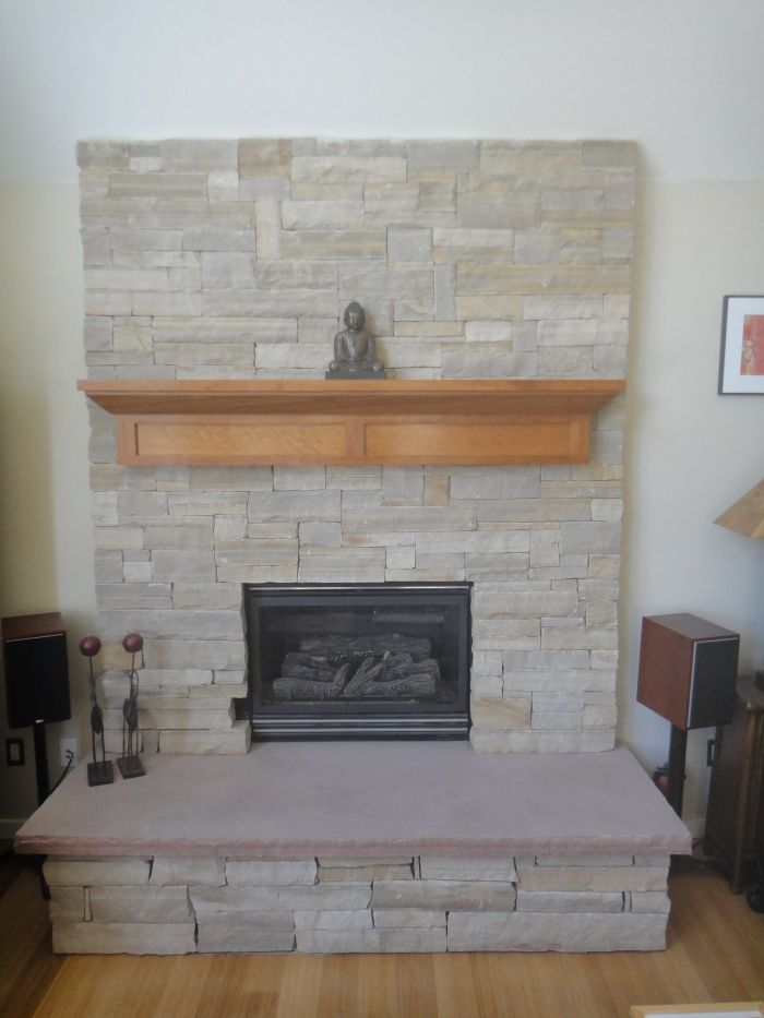 Like this stone, but would want an aged wood slab as a mantel