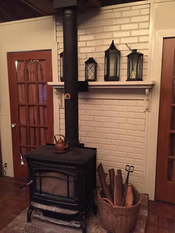Painted The Brick Behind The Wood Stove White Wood Stove Decor Wood Stove Fireplace Wood Stove
