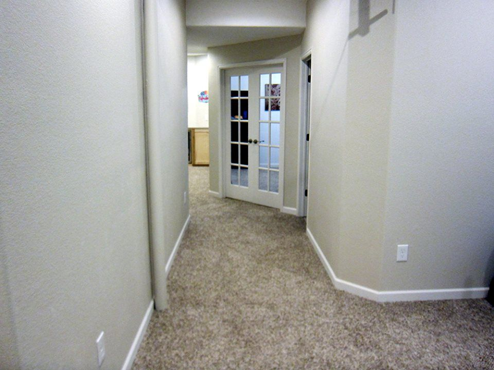 View Down The Hallway Into The Bedroom With French Doors. Basement Bedroom  Ideas, See