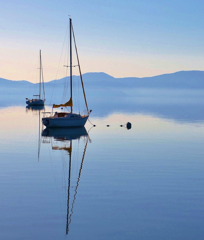 Sailboat On The Still Blue Water Of Lake Tahoe Sailboat Reflection