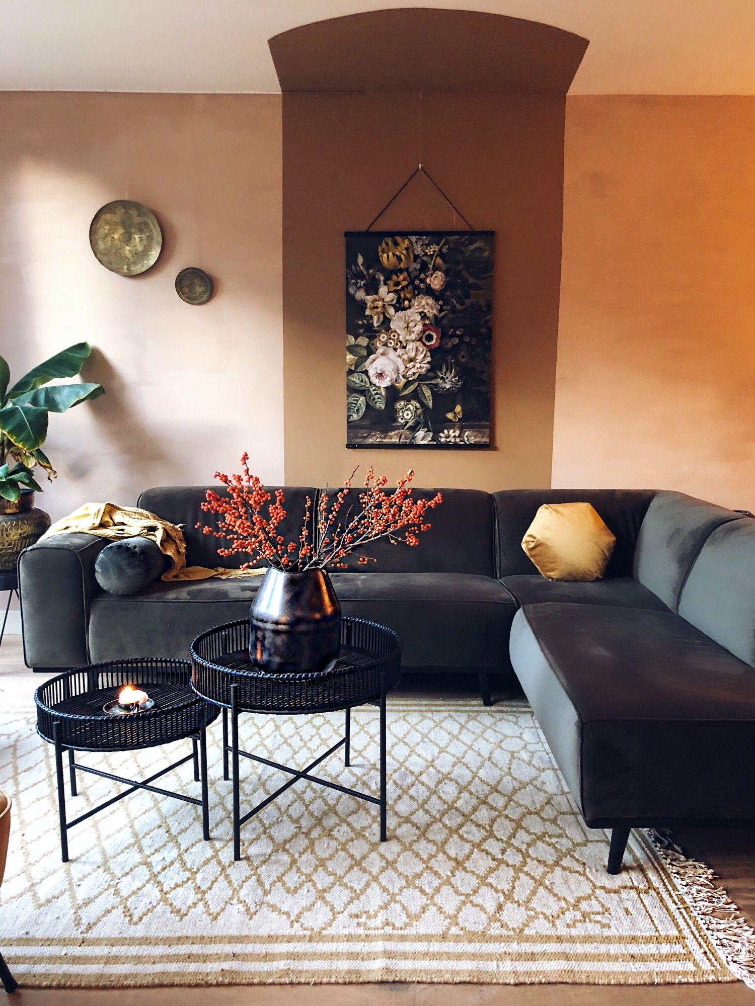 Photo of Boho livingroom. Velvet bank: Statement hoekbank € 1450, Rotan salon tafeltjes…