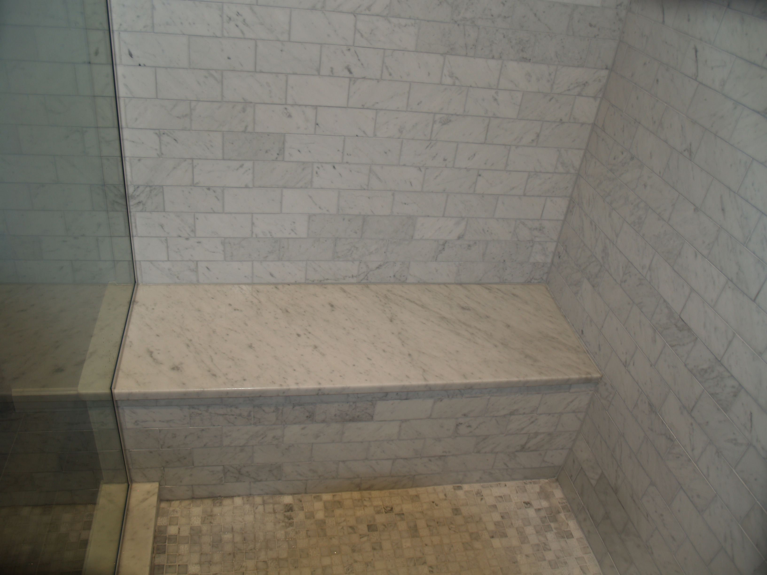 Carrera marble shower seat | Bathrooms by: Dishington Construction ...