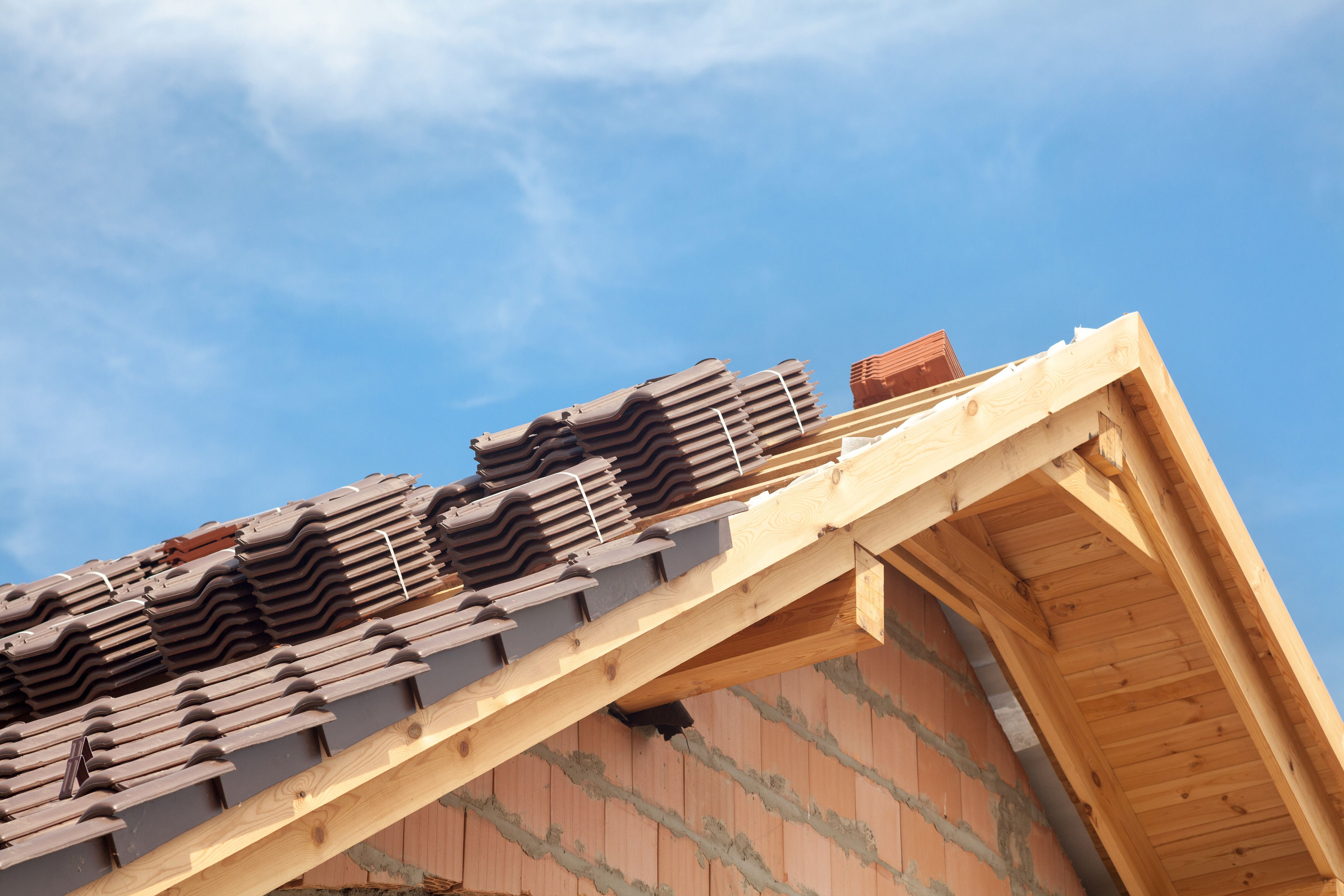How To Increase The Pitch By Building A Roof Over An Existing Roof Hunker Building Roof Building Roof Trusses