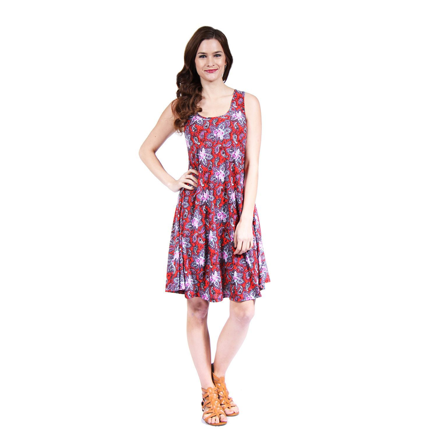 Slight stretch in construction and sleeveless style finish this pullover dress with a chic, comfortable fit. The abstract paisley design of complimentary reds and pinks are eye-catching, and are perfect for any occasion.
