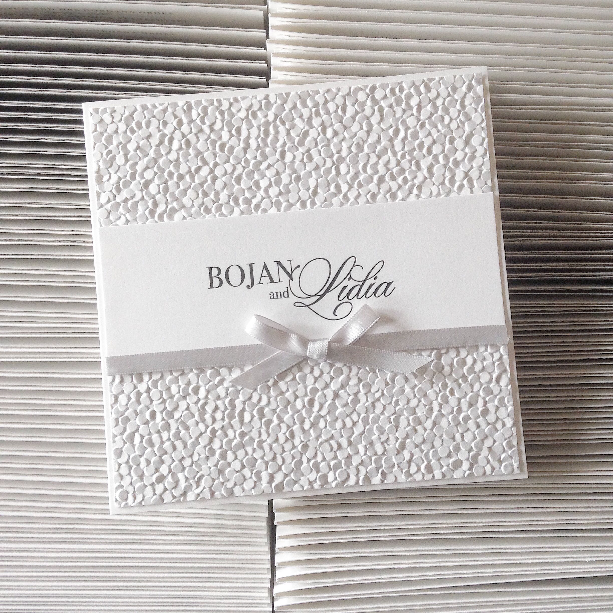 Classic square wedding invitation with pebble embossed paper and ...